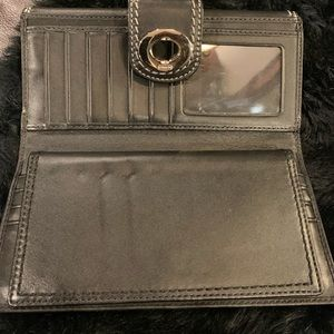 Black Coach wallet with silver buckle 8in x 4in